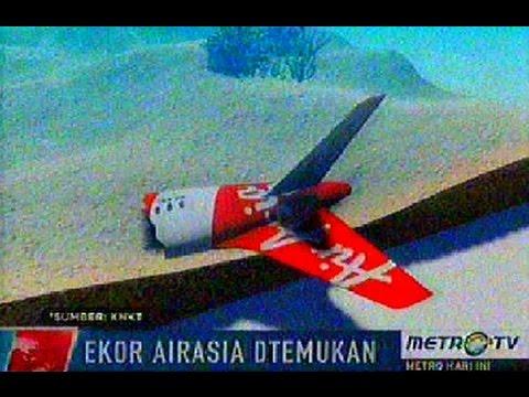Ekor pesawat AirAsia QZ8501 akhirnya berhasil diangkat